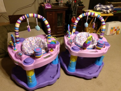 pink and purple excersaucers for twin girls